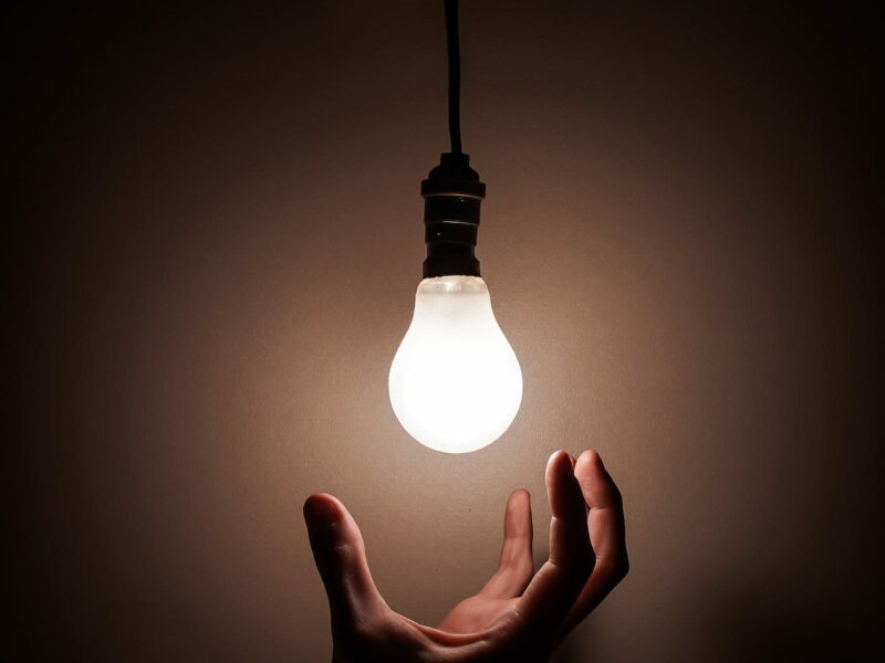 person-holding-white-light-bulb-3651820